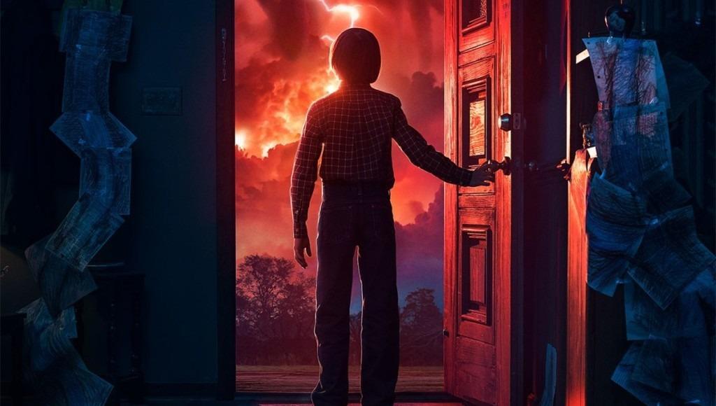Will abre a porta e vê o mundo com nuvens vermelhas em Stranger Things